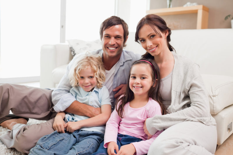 Family relaxing on a sofa in a living room