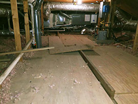 Before picture of a Wooden attic deck with holes