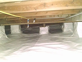 a newly installed Vapor Seal water barrier underneath a home