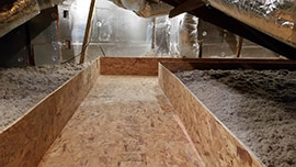 A Walkway being built in the attic of a home